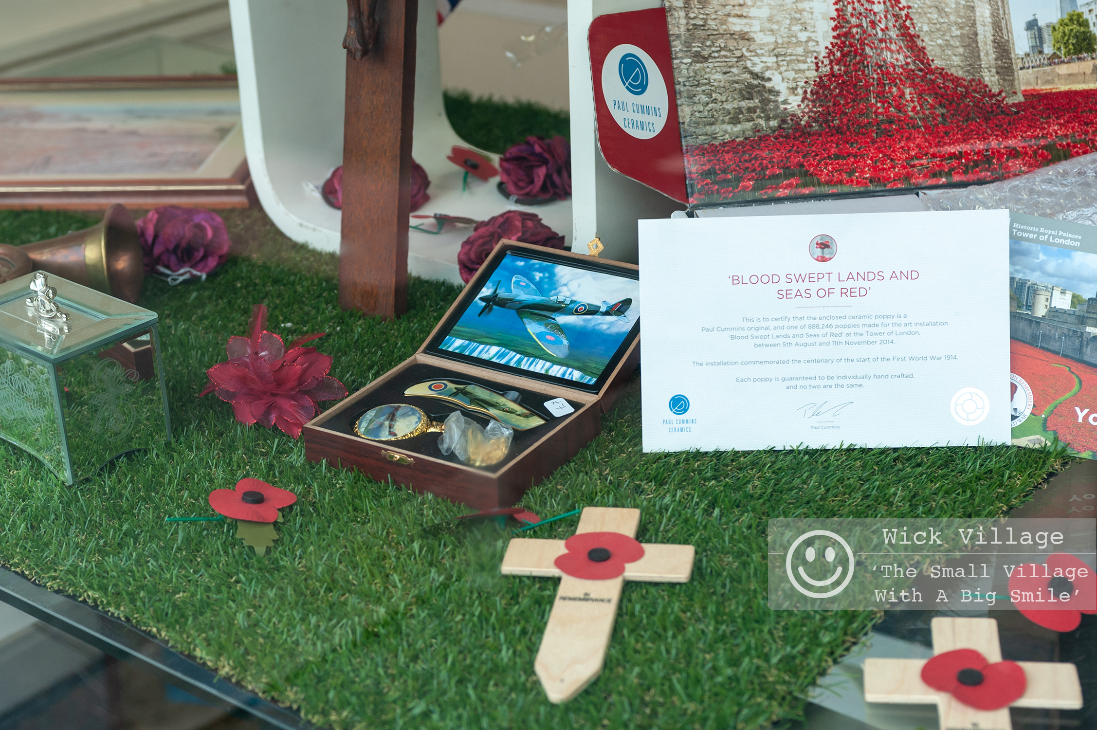 Wick, Littlehampton, West Sussex, UK. 9th November 2018. Wick Village Traders mark the centenary of the end of the First World War with shop window displays. In Pic: The St Barnabas House charity shop window display.