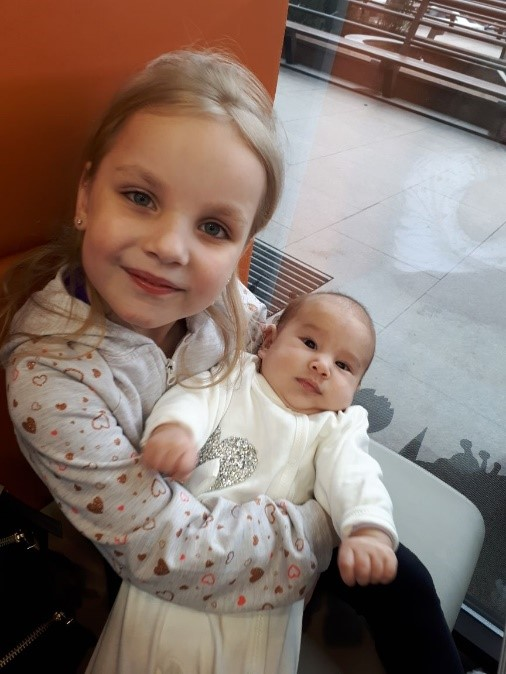Sophia with her new little cousin