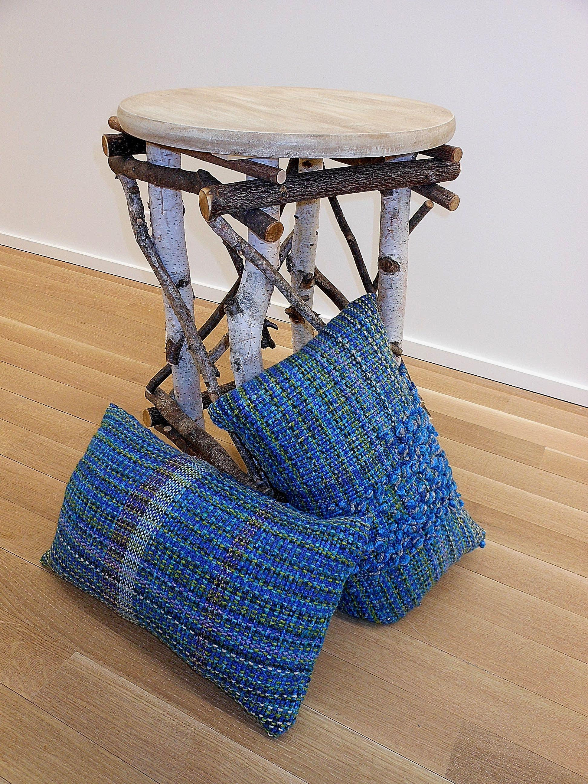 "Cathy Siterlit, Birch Twig Table [24"" high] with handwoven throw pillows"