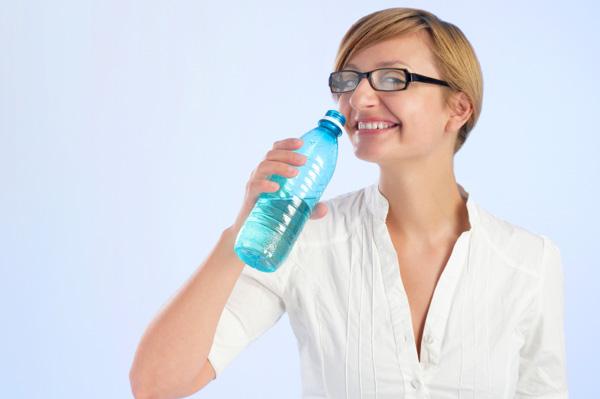 woman-drinking-from-water-bottle