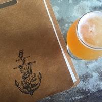helm menu and beer.jpg