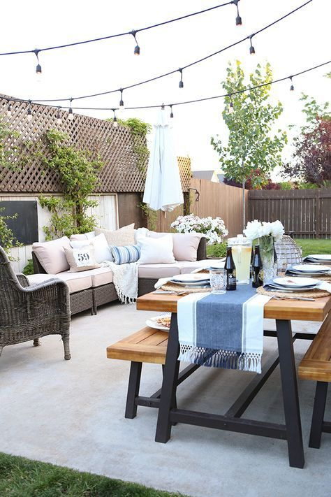 Small space patio that accommodates both a dining and lounging space! Dining table from World Market.