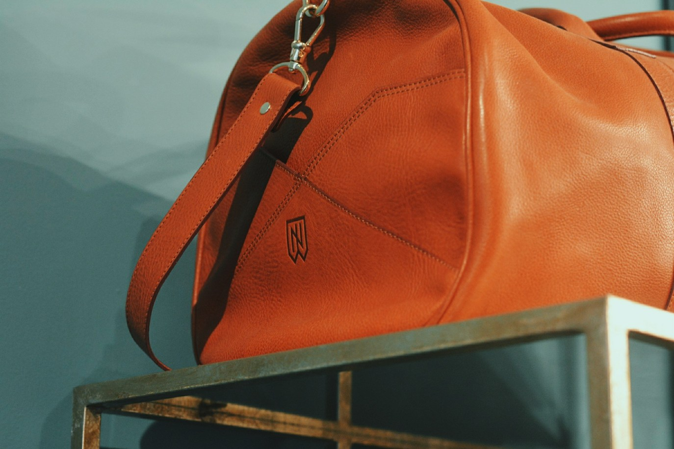 The new Noah Waxman monogram imprinted into a handcrafted leather bag.
