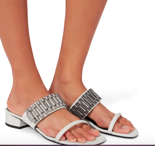 We love these funky sandals featuring metal hardware resembling a watch strap gives a distinctive style to these white slide sandals. Pair with a silver watch to tie the look together.