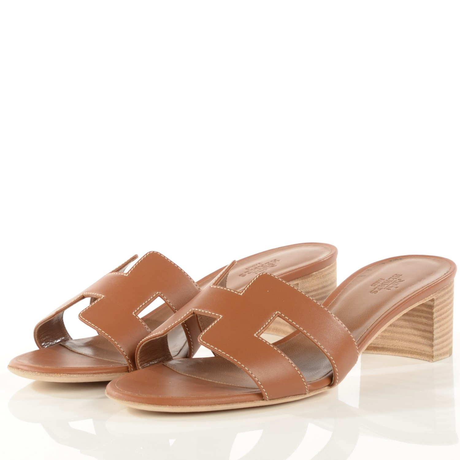 """For all of our classic gals out there, there is nothing more timeless than a pair of Hermes sandals. Pair with denim, a sheath dress, or mini skirt and blouse for the perfect """"off duty"""" look."""
