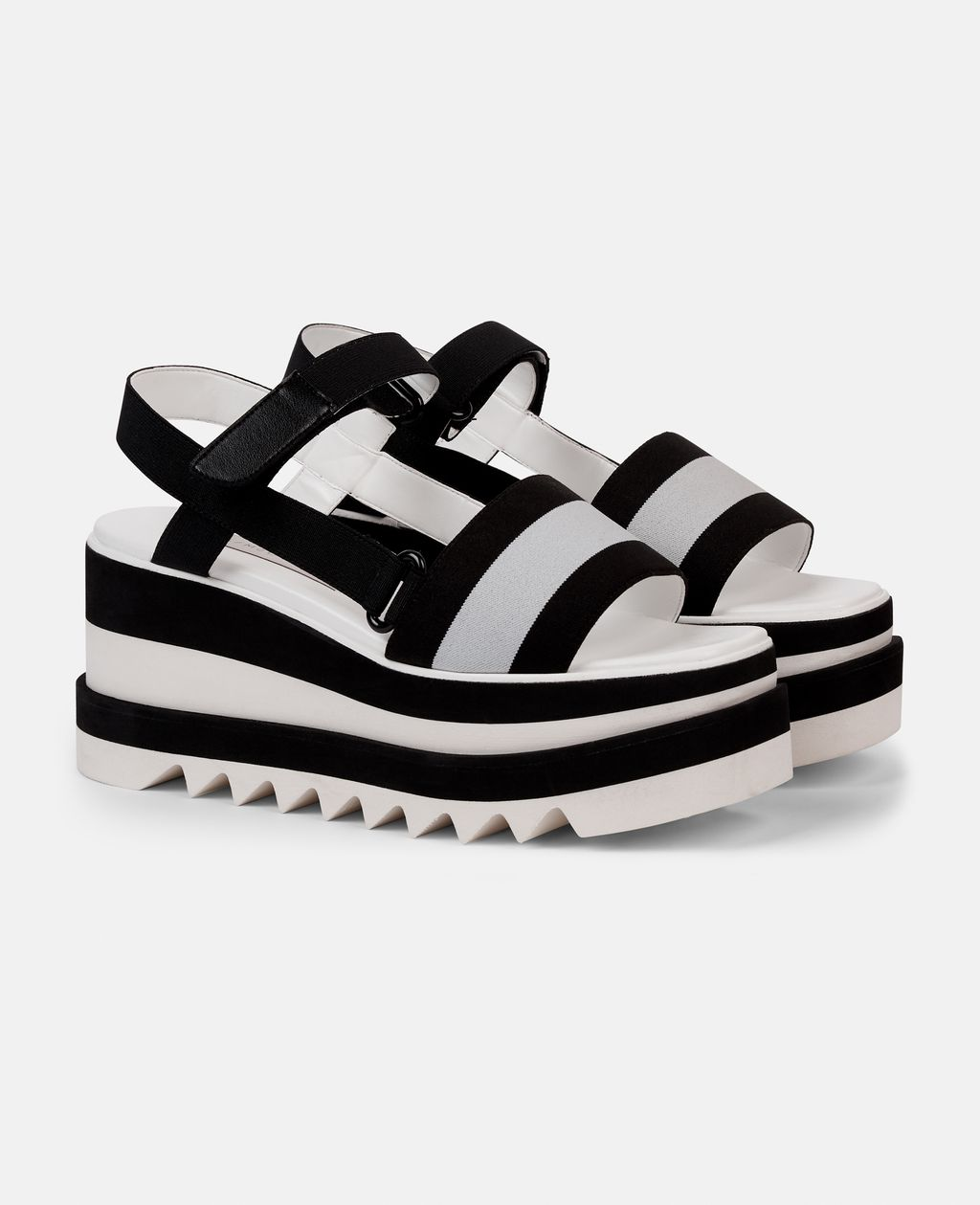 We were already obsessed with the Sneak Elyse by Stella, it is no surprise that we are also obsessing over the Striped Platform Slides. These Minimalist slides featuring contrasting striped band and signature raw-edged platform sole. Pair with a dress, jeans, or just about thing to complete your easy summer ensemble.