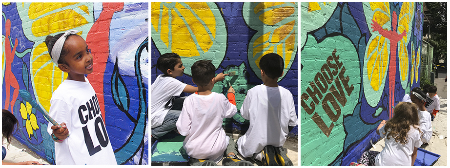 Local school children help paint the mural