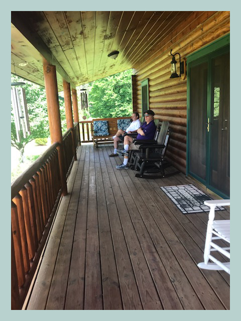 Sitting on Melody's and Greg's long porch.