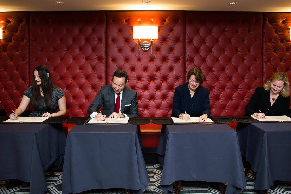 Guelbart, left, at the AccorHotels signing of The Code.