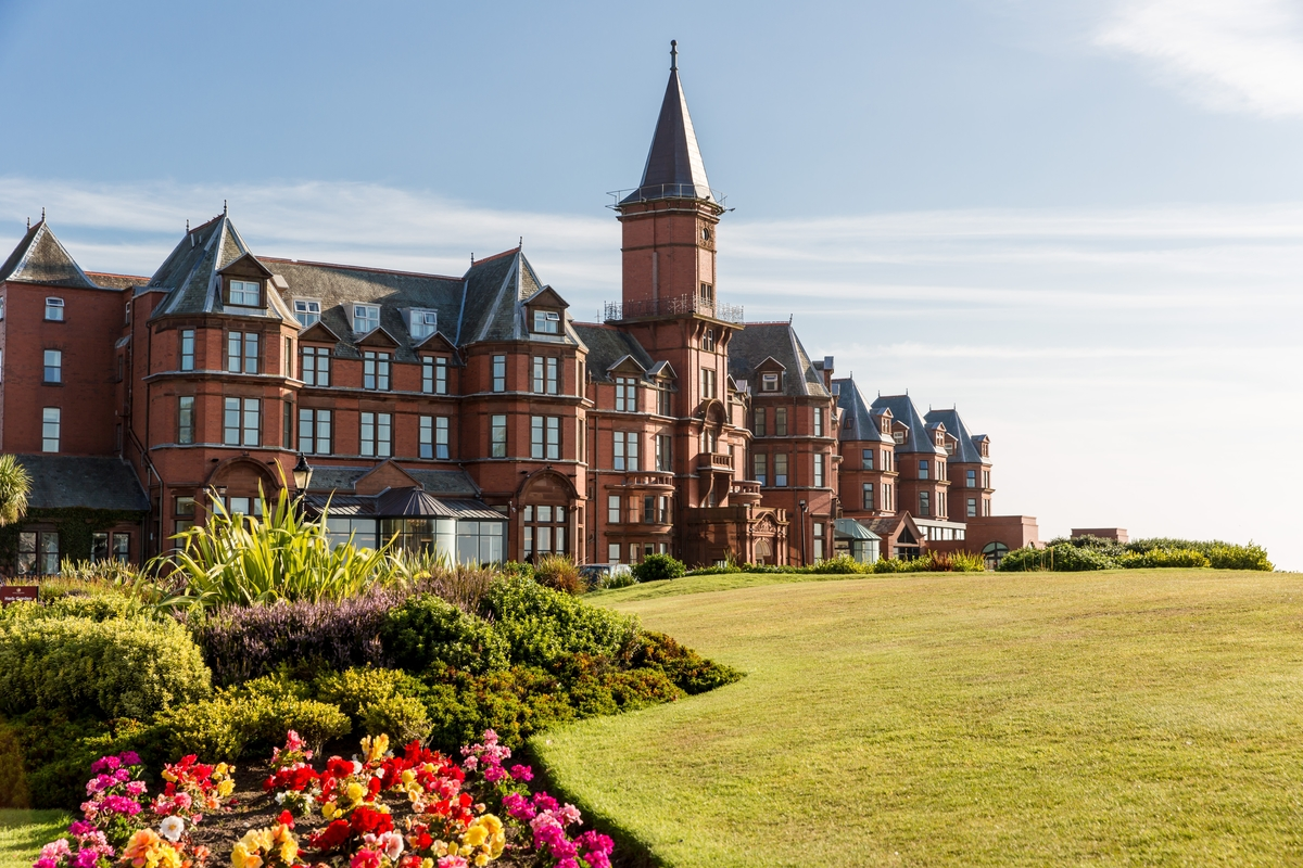 SLIEVE DONARD RESORT & SPA - NEWCASTLE, COUNTY DOWN - Nestled at the foot of the Mountains of Mourne, the Slieve Donard Resort and Spa sits on six acres of immaculate private grounds. A golden strand of beach borders one side and the mighty Royal County Down golf links frames the other.