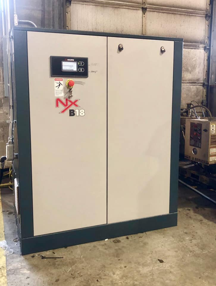25 HP FS-Curtis Nx rotary screw compressor installed at a printing shop