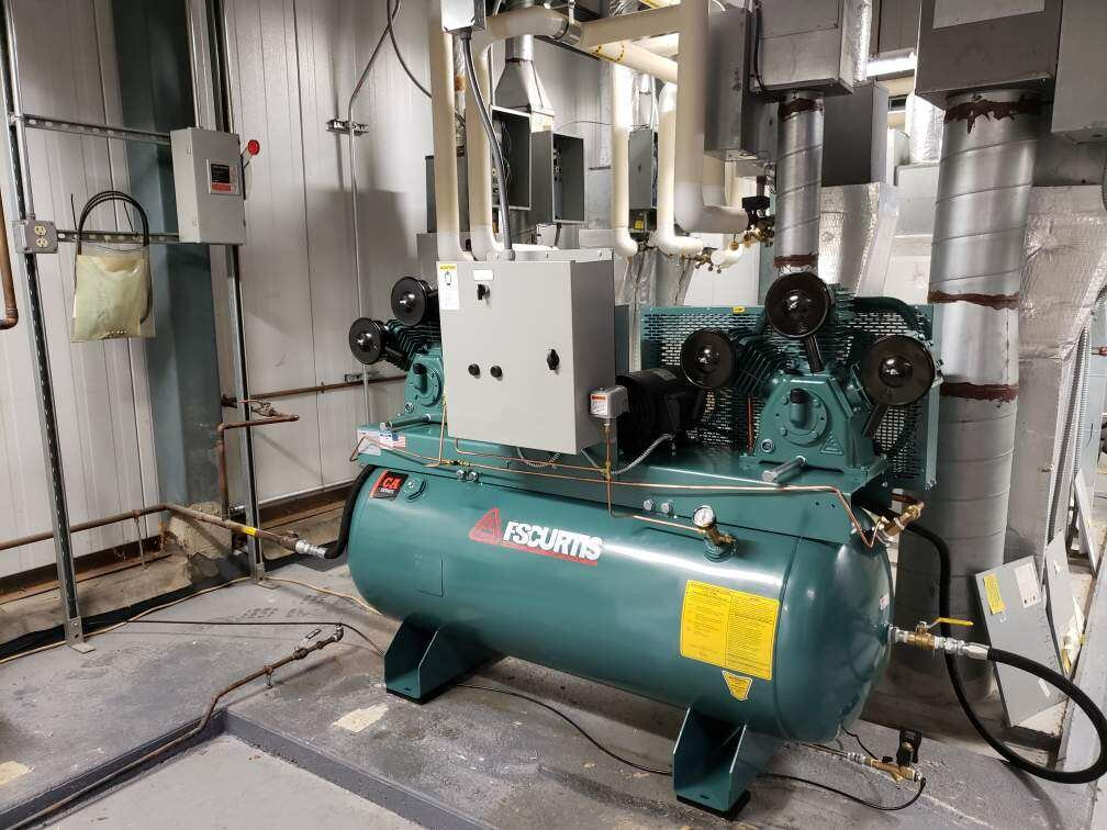 FS-Curtis CA5 duplex reciprocating compressor installed for a climate controlled pneumatic system