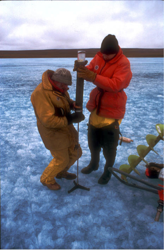 Extruding a sediment core from a lake on Banks Island