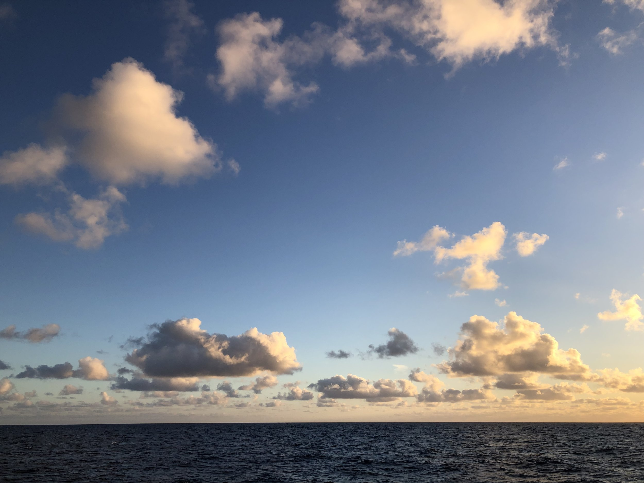 Puffy clouds over Gorda Ridge, Pacific Ocean