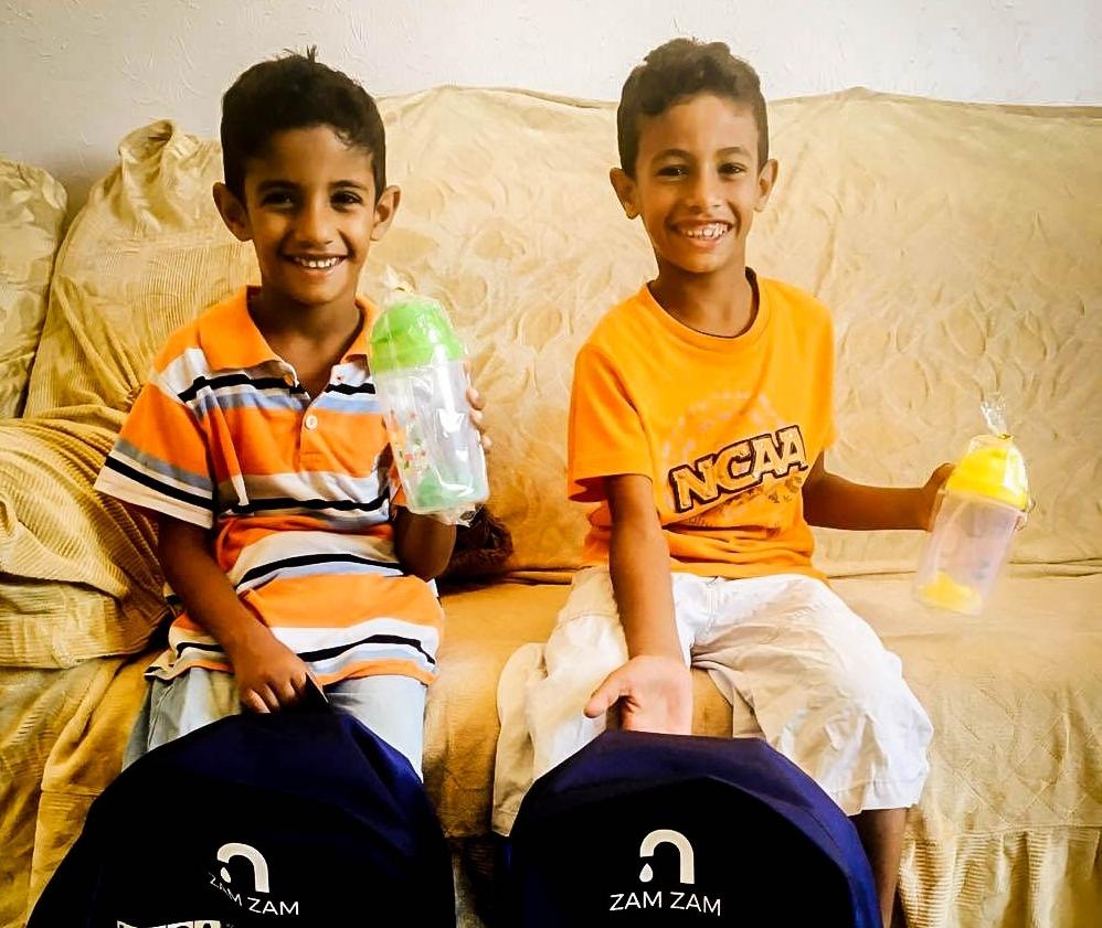 Gaza backpacks with boys.jpg