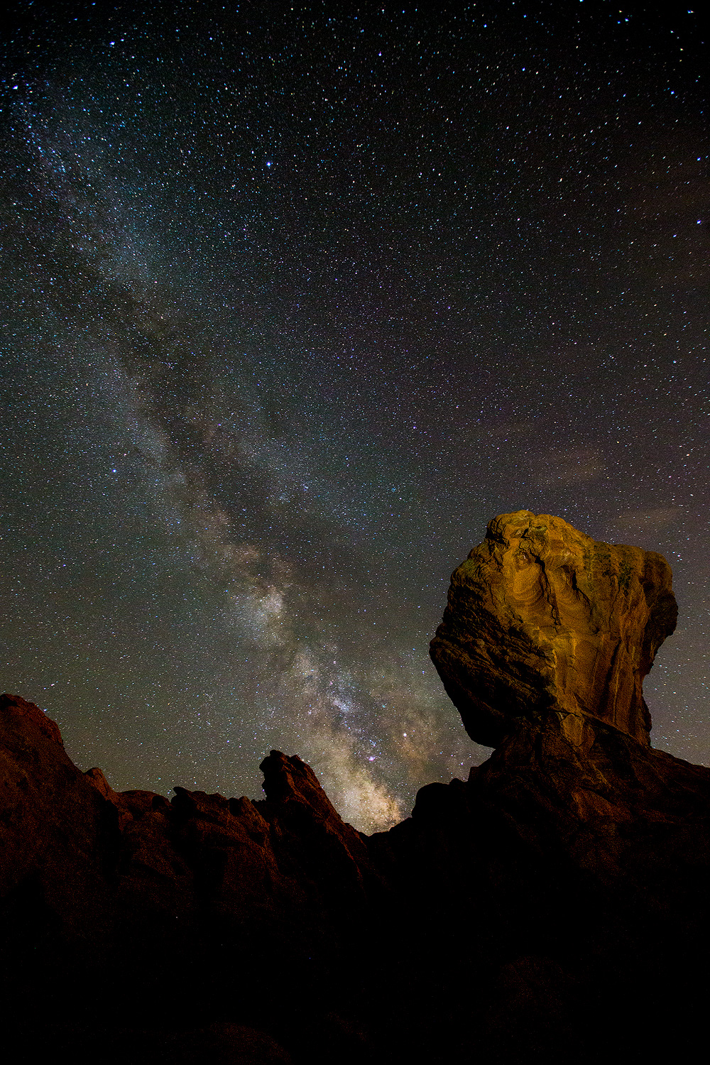 The Milky Way rises above one of the many unusual rock formations in the park.
