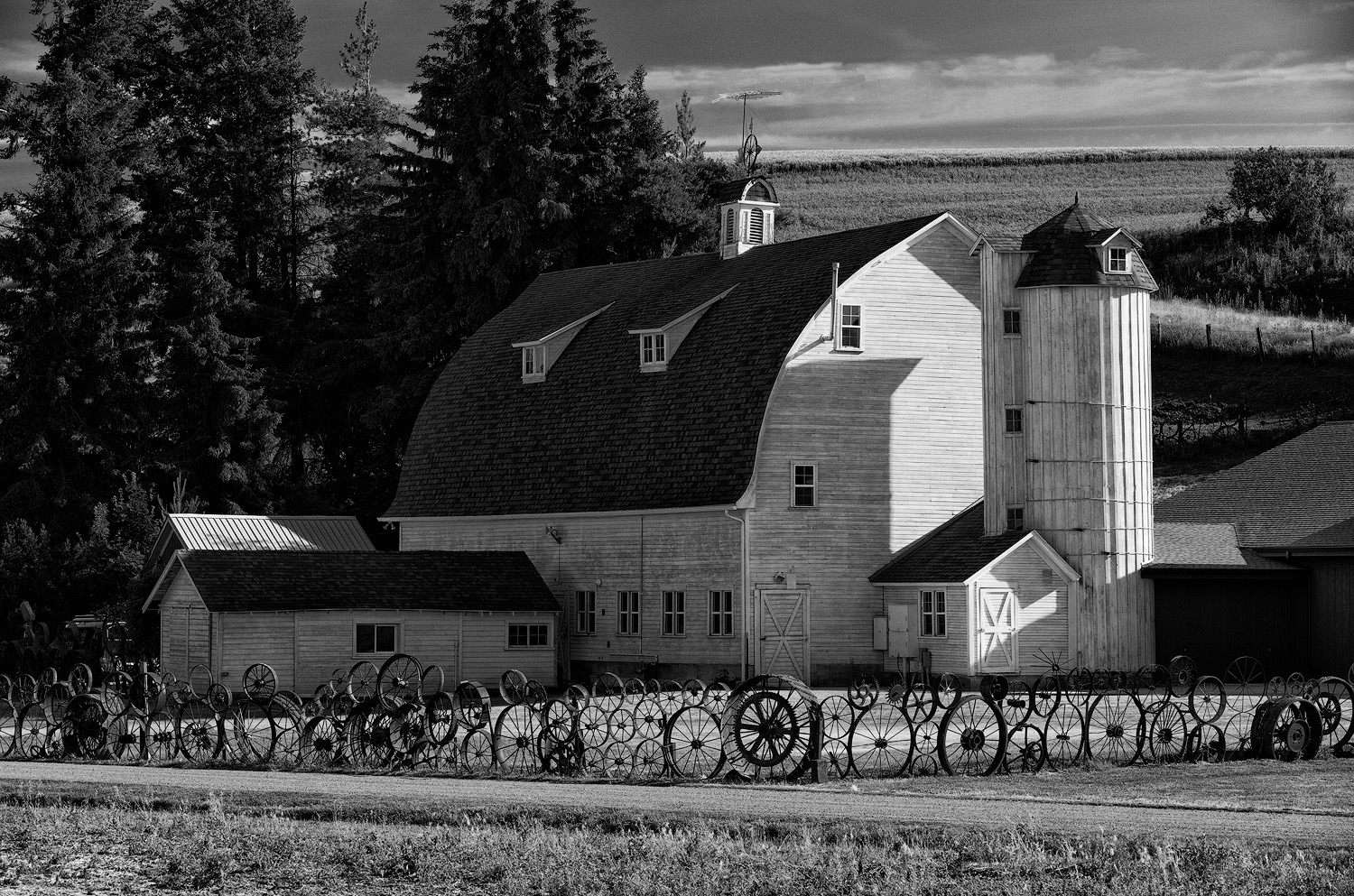 """Dahmen Barn just outside Uniontown, Washington is a haven for local artists and home to the """"folk art"""" wheel fence."""