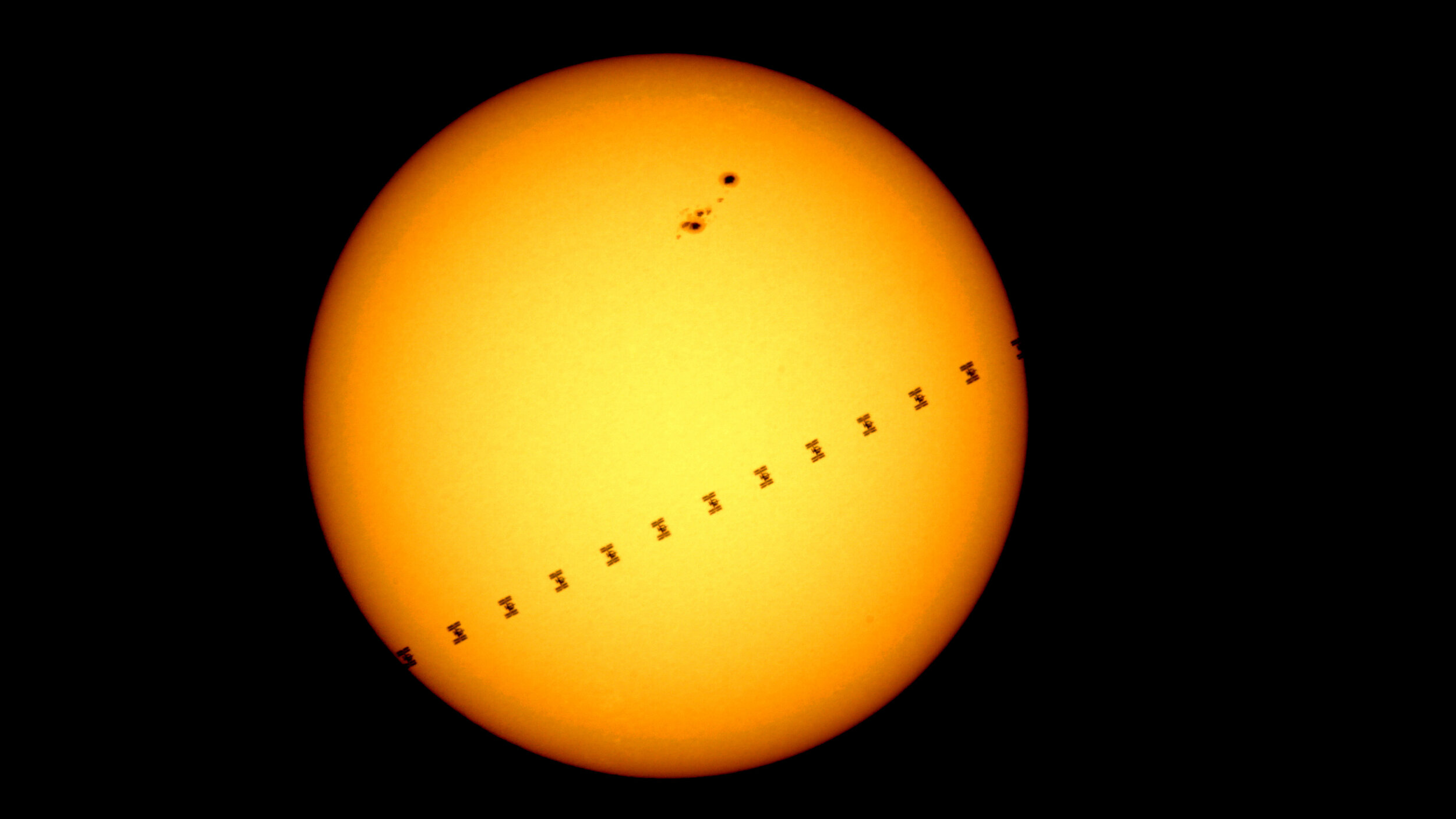 The International Space Station flies in front of the sun, July 2015, Cocoa, Florida.
