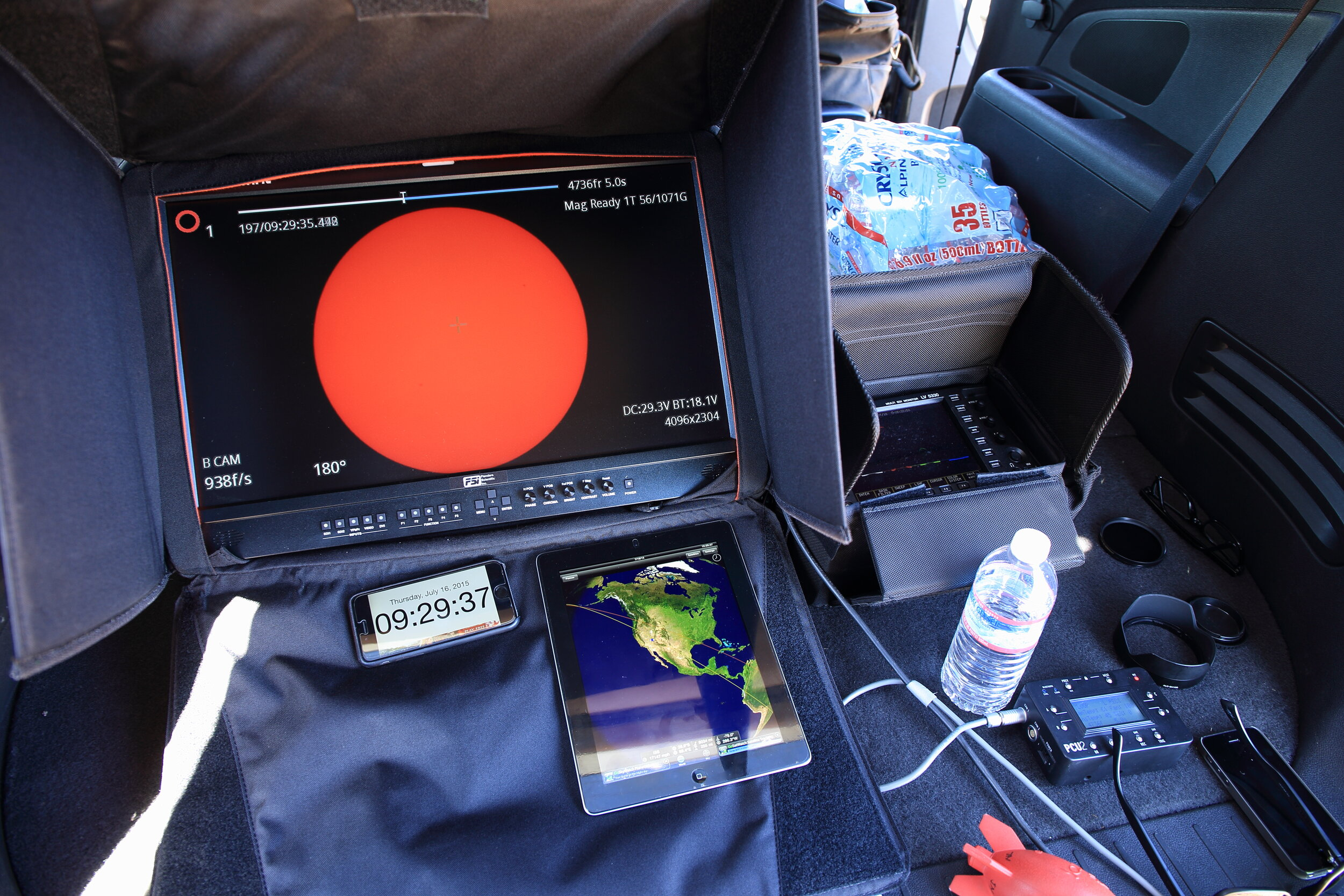 """Here is my """"command center"""" for a high-speed sun crossing video shoot I did for the IMAX space film  A Beautiful Planet.  Below the big monitor you see my iPhone running ClockZ, and my iPad running another helpful app called GoISSWatch."""