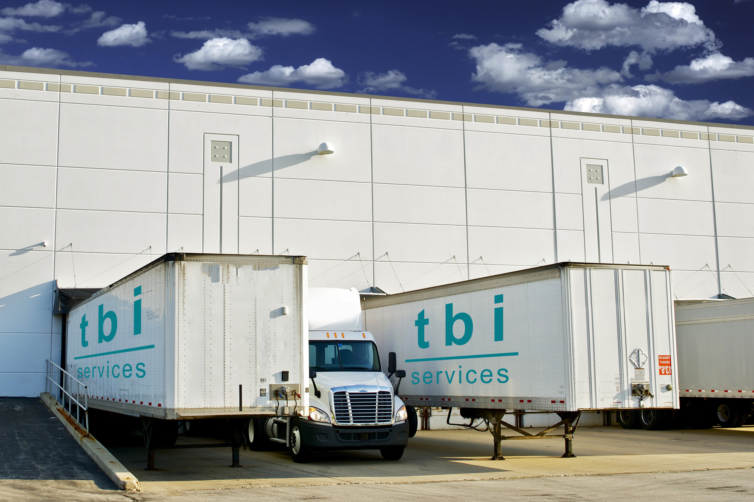 warehouse loading trucks blue logo.jpg