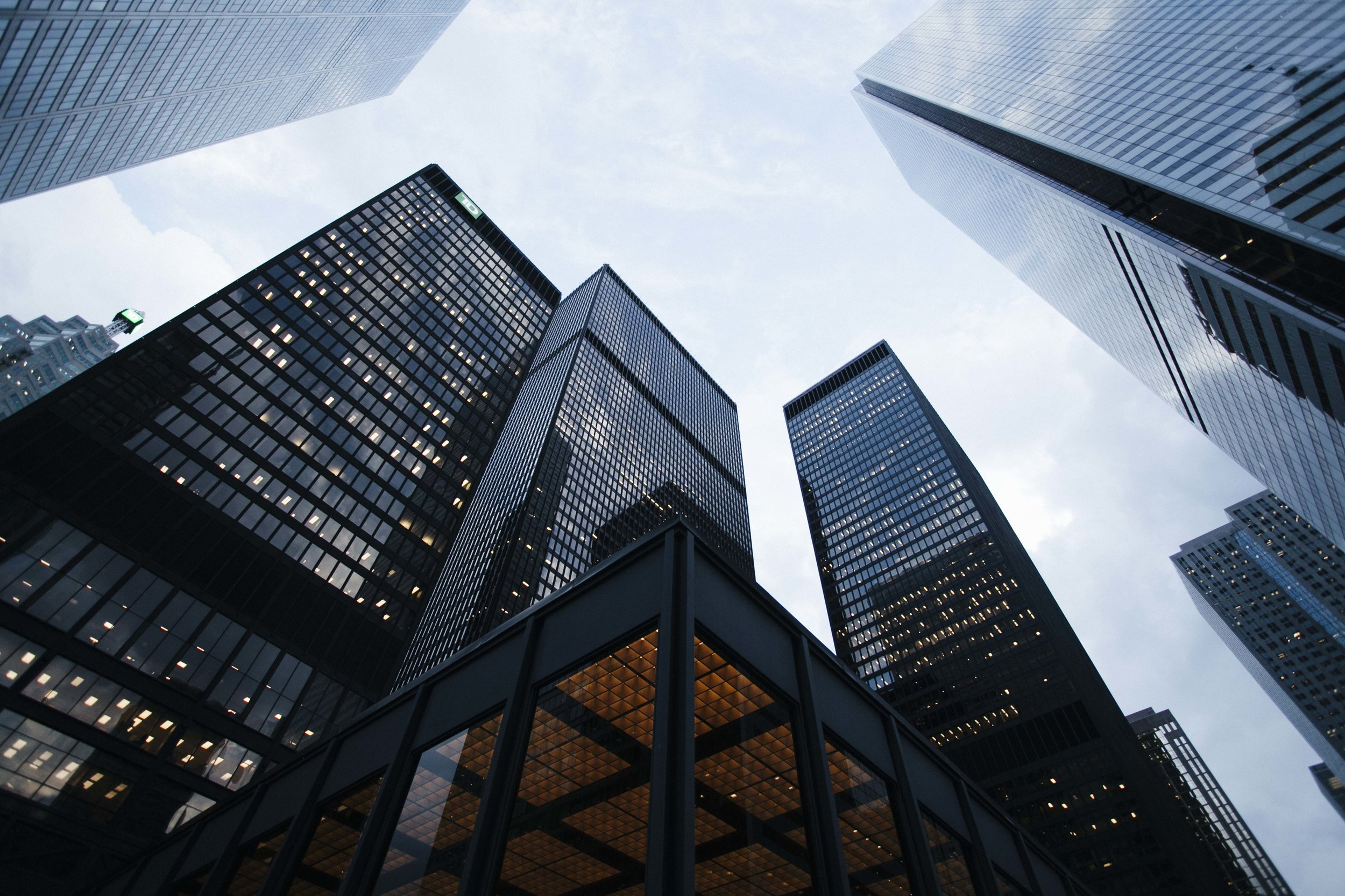 Looking up at tall buildings in a city