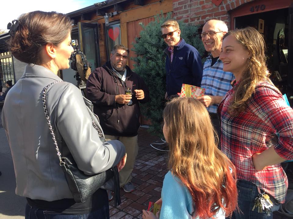 Mayor Libby Schaaf and Councilmember Dan Kalb with friends and local media shopping Temescal Alley on Plaid Friday.