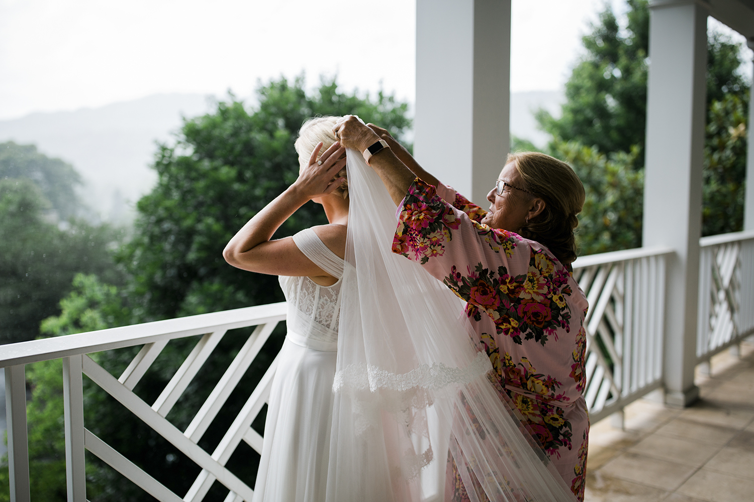 Jessica's mom helps her get ready at the Greenbrier in White Sulphur Springs, WV. The house that they rented to get ready in had this gorgeous balcony outside the bedroom and we were able to use it for a lot of her bridal portraits, first look, getting ready shots and details.