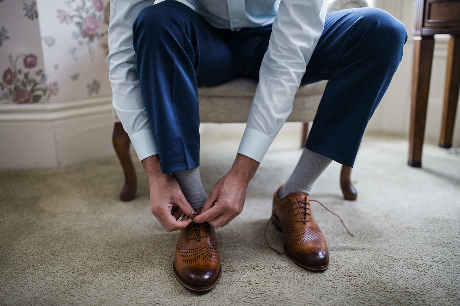 A groom gets ready for a Virginia wedding at the Joshua Wilton House in Harrisonburg. Want to have the best getting ready photos ever? Make sure to pick a getting ready space with lots of natural light.