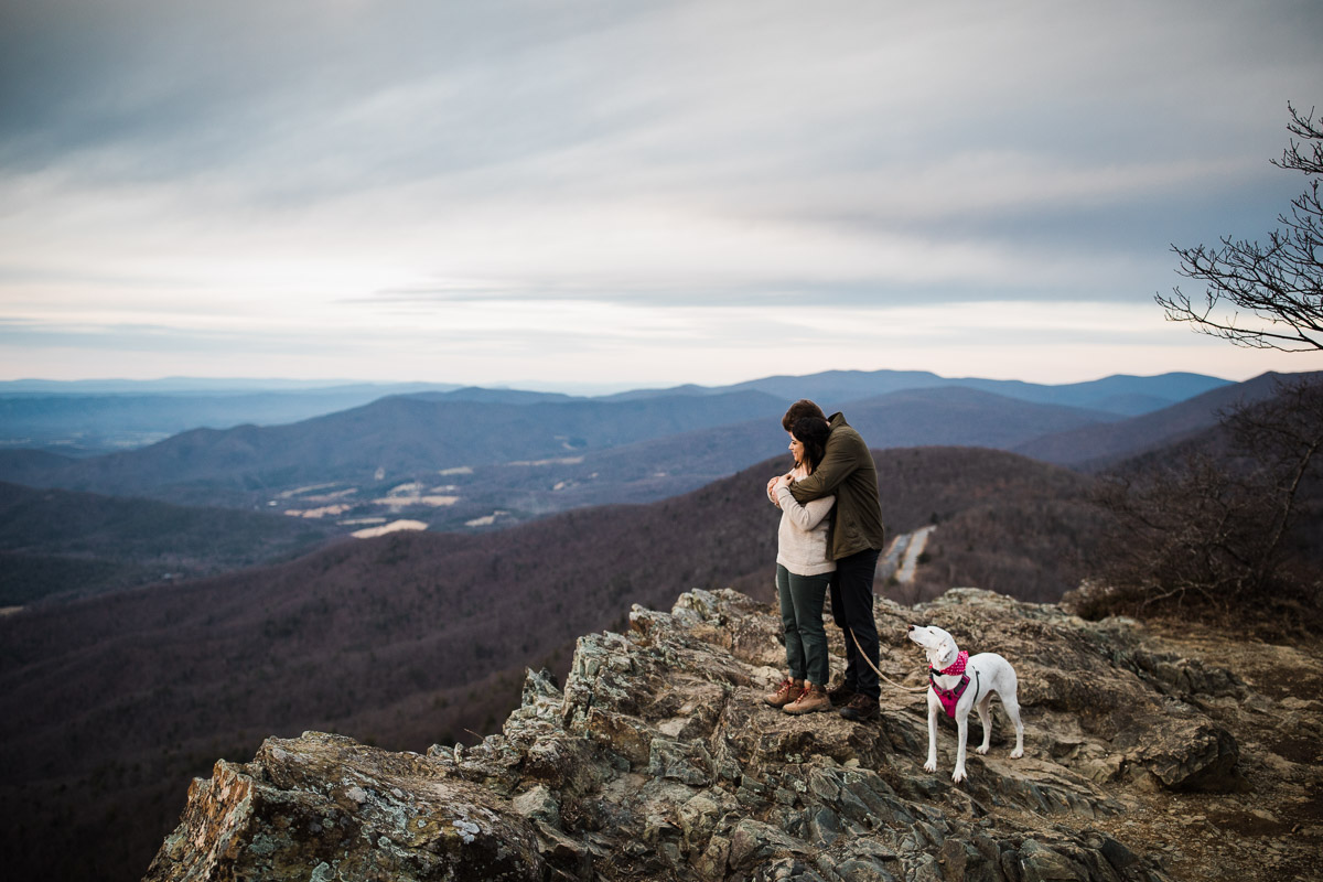 Vicki, Stephen and their pup enjoying the sunset at Little Stony Man hike on Skyline Drive of Shenandoah National Park.