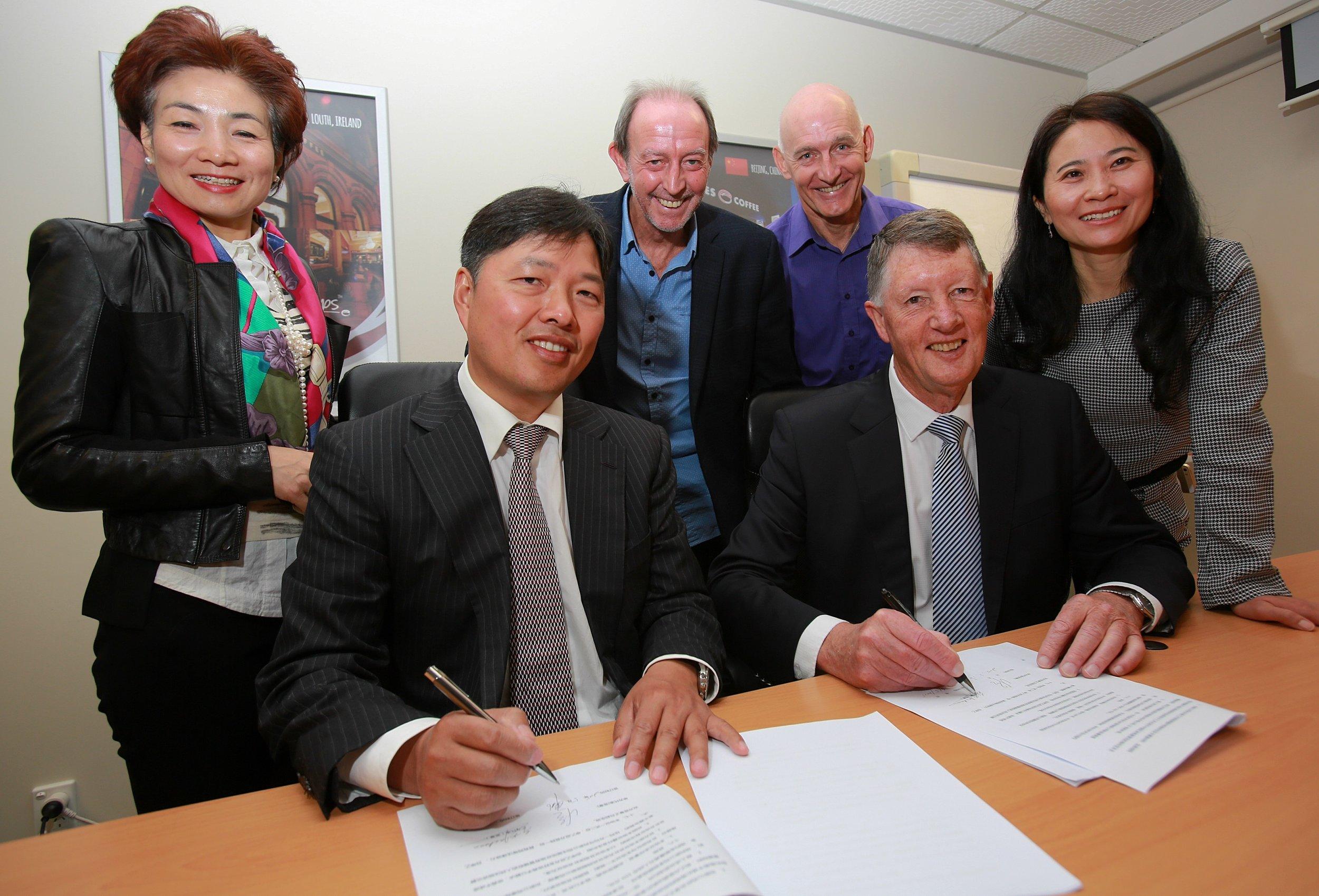 BBG Chairman Wang Tian (left) and Cooks Global Foods Executive Chairman Keith Jackson sign the JV agreement.