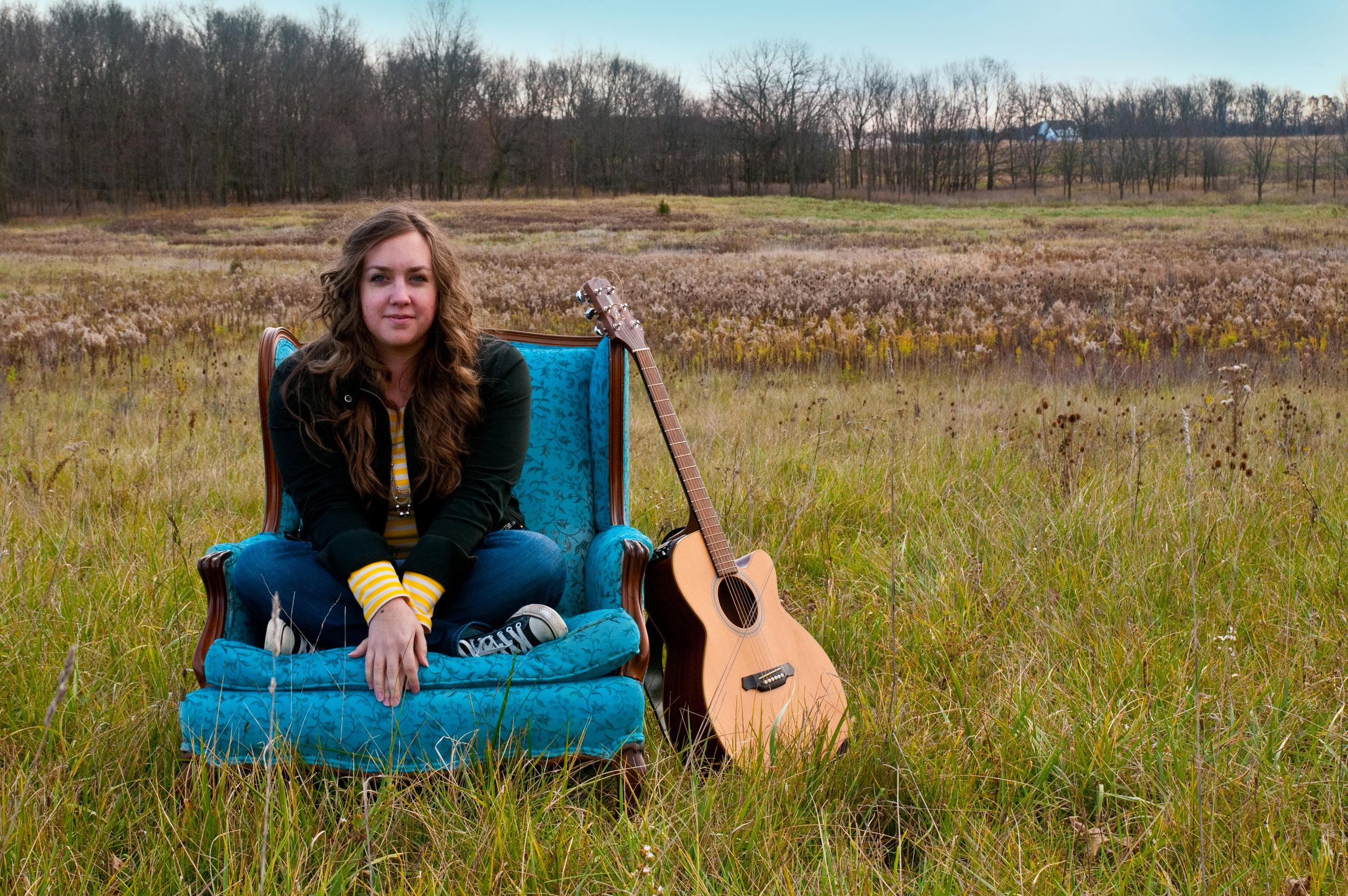 Amy Cox-blue chair-field-guitar.jpg