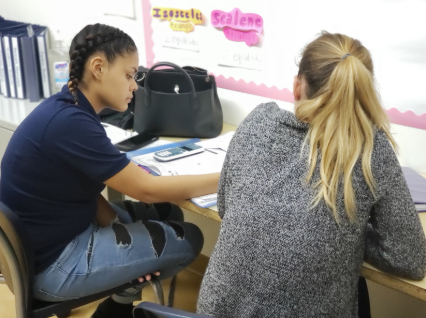 Tutoring spotlight - Pictured: Bessie Gonzalez, recent GED graduate, being tutored by DC volunteer, Katie Williams.