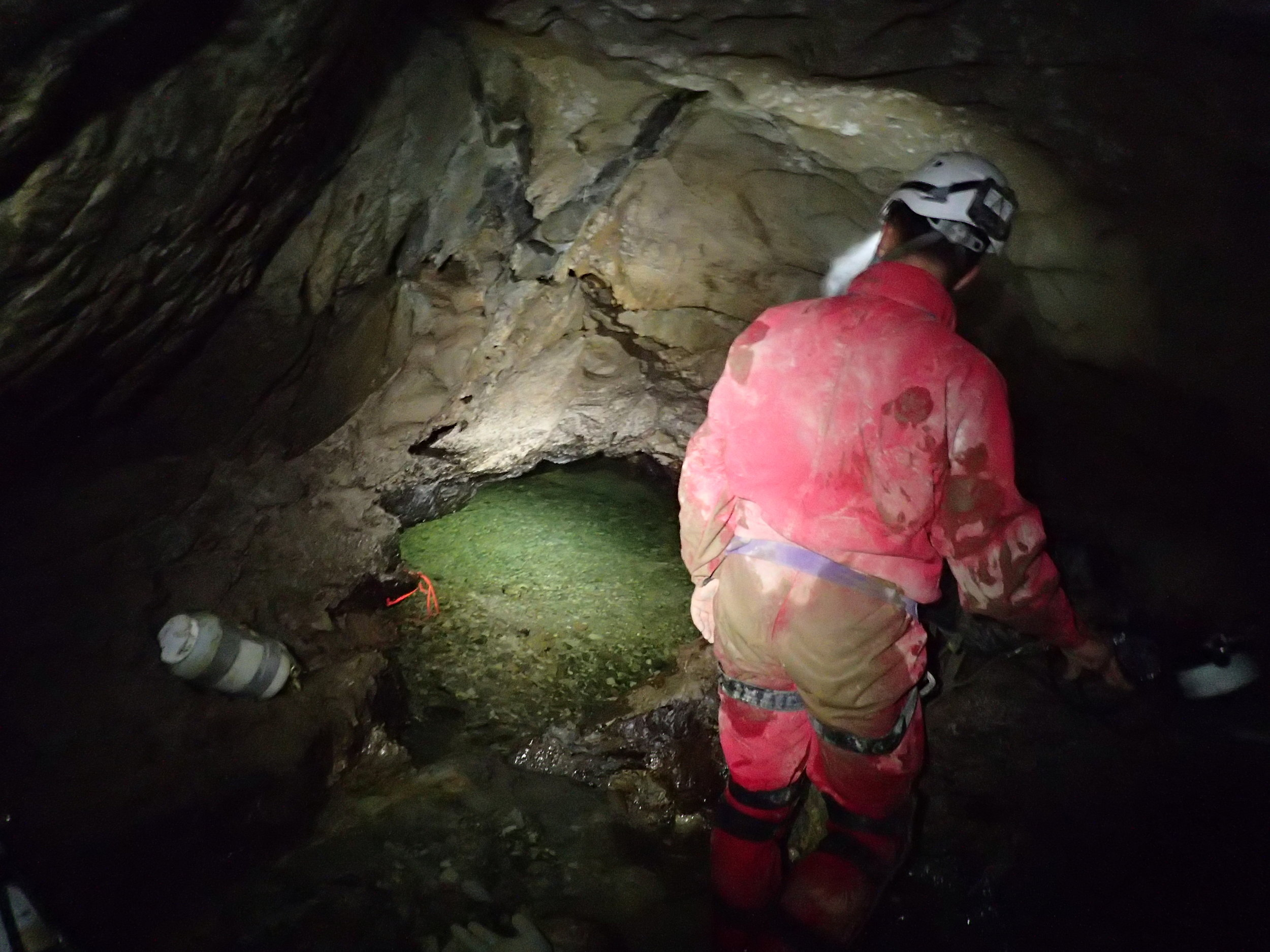 Jason Richards looks into Sump 1 at Whistling Cave, BC