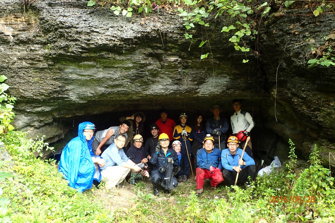Our Korean crew at the entrance. Despite the rain, and short cave, everyone was having fun.