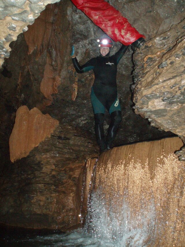 Chrissy standing on the plunge pool- a climb-up from deep water is required to pass this.