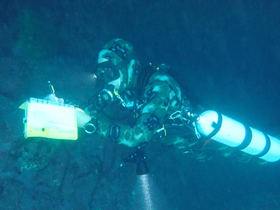 Sketching the cave on the second dive.