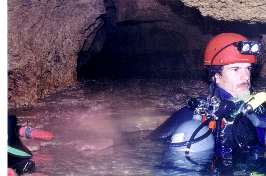 Jerry Fant, resting between Sump 1 and Sump 2. The gear shown indicates just how new we were to sump diving, and the passage beyond, an uncomfortably long stoopway, was just terribly carrying steel tanks without bags. What should have been a fairly moderate trip, turned into an epic workout.