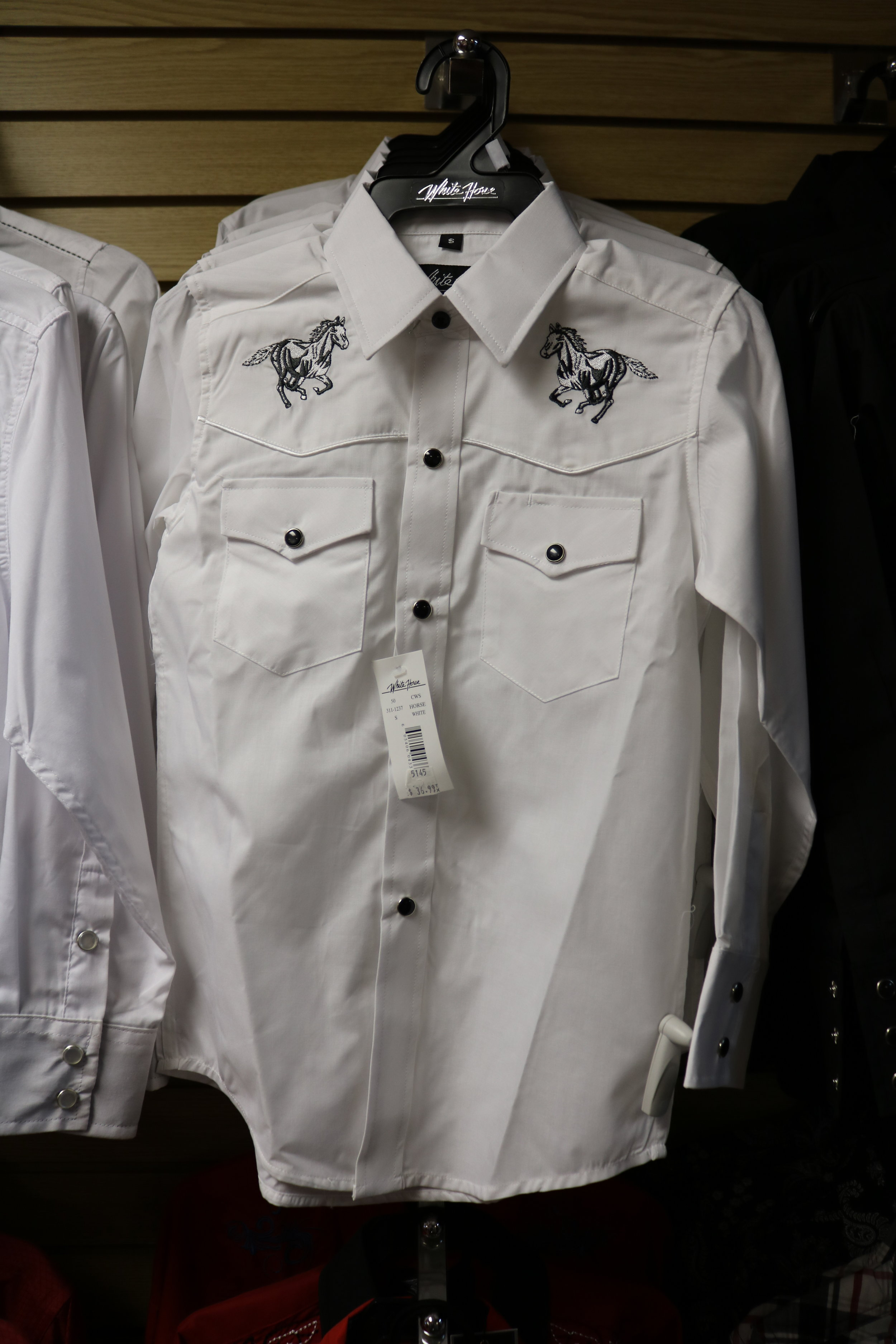 Wide variety of dress shirts.