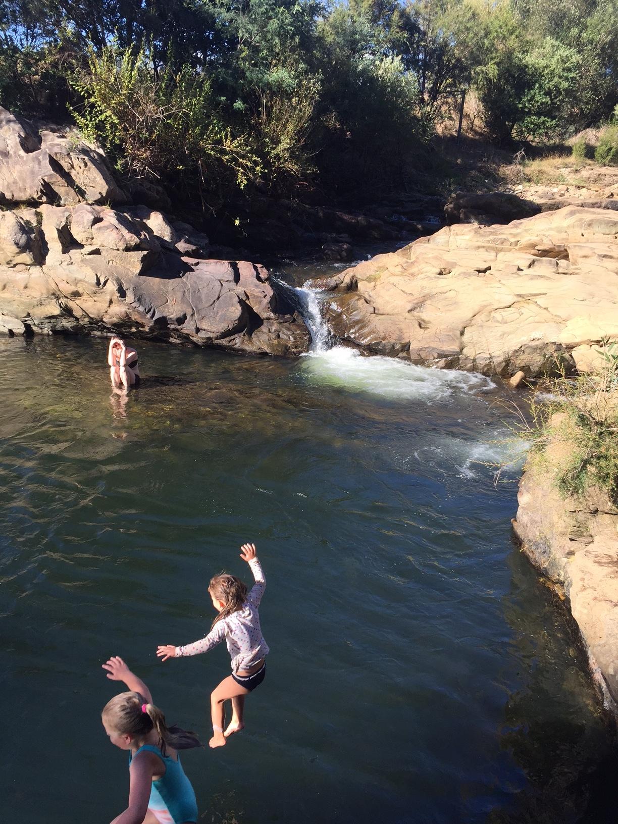 Rock jumping at Sinclairs waterhole