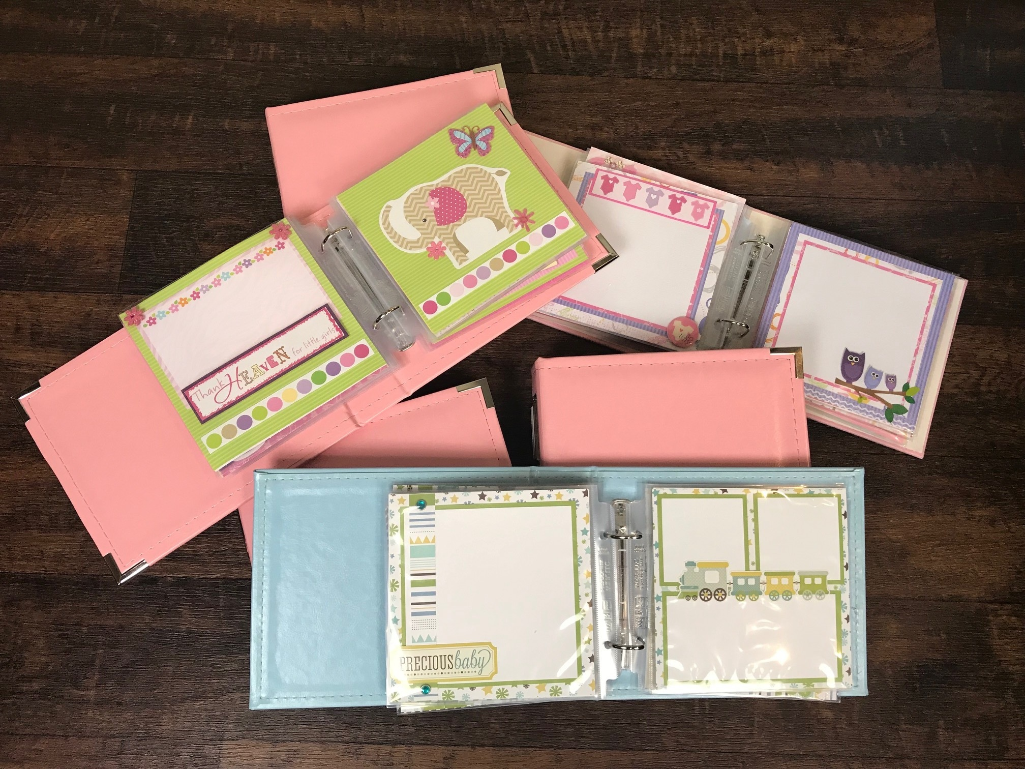 "6"" by 6"" - Small and cute! These 6x6 binders come with 20 ready made pages! Just add your pictures to have a complete scrapbook to document those important life milestones. All pages come with a high quality binder for a complete book!"