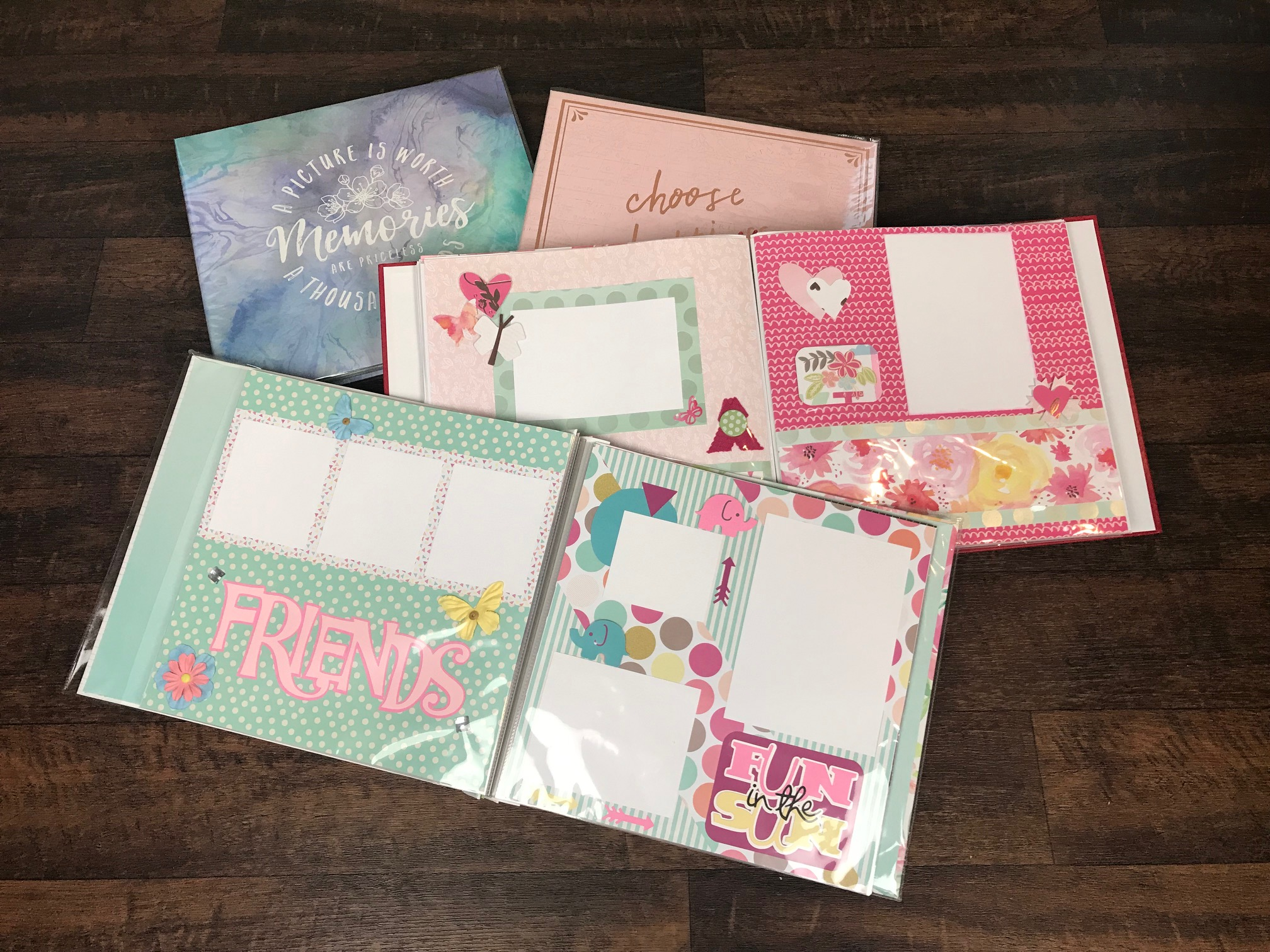 "12"" by 12"" - Large 12 inch Scrapbook ready for your pictures. Enjoy 20 large, fun, and bright pages in each book. All pages come with a high quality binder for a complete book!"
