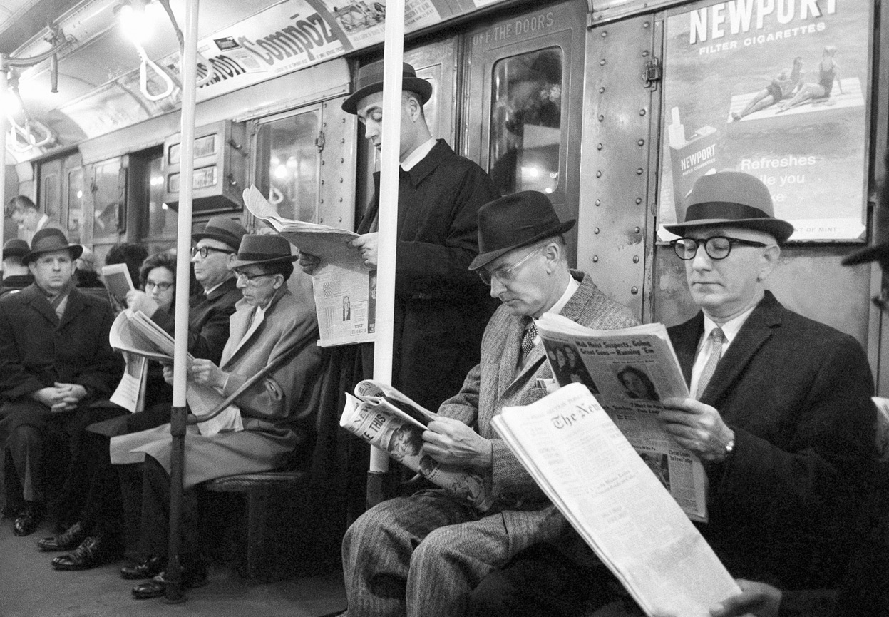 New York Times -Men Reading on Subway