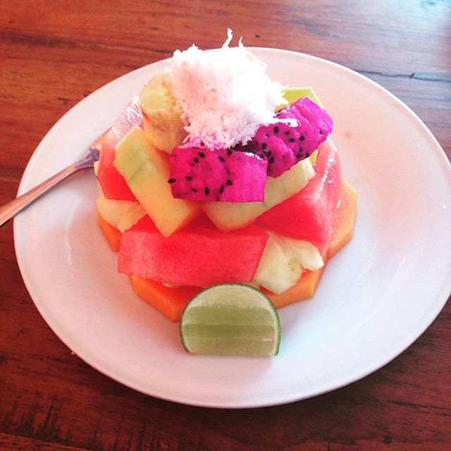 Bali dreaming 💖Bali is a GREAT place to eat if you're vegan. This is the adorable fruit salad tower they serve at our accommodation every morning. 🍉🍌🍍🔺