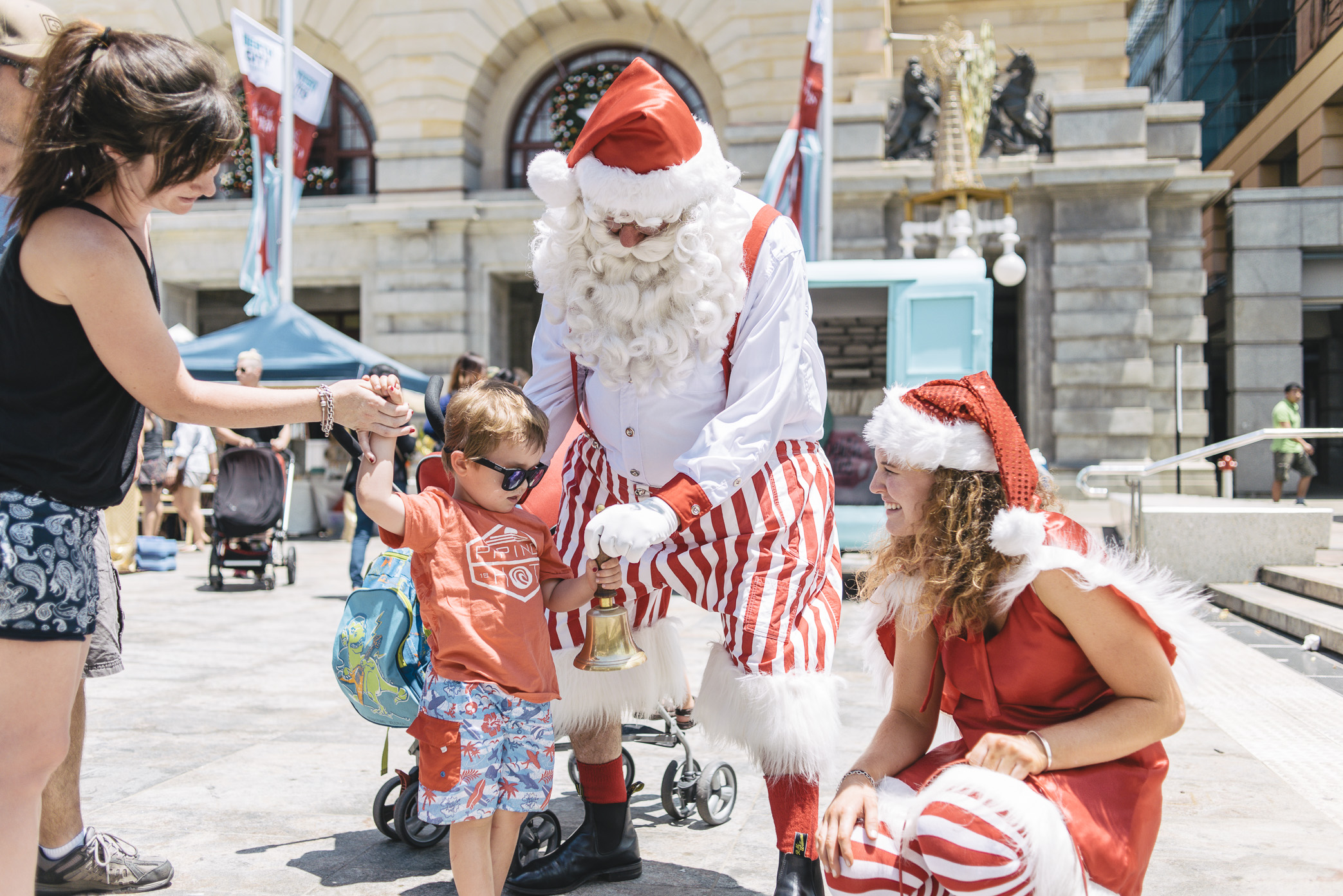 Santa: keeping cool,  gift-giving in Forrest Place.