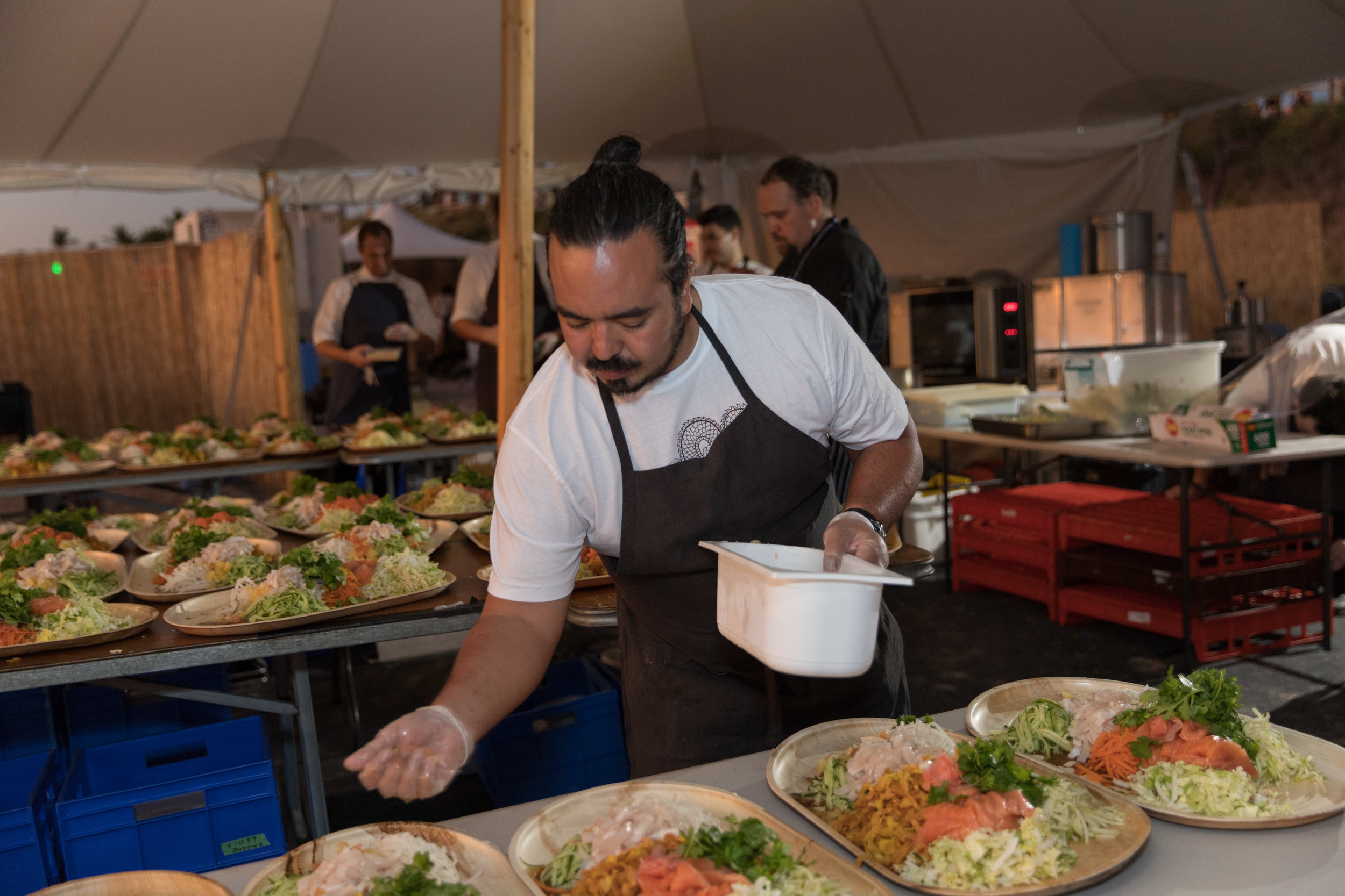 Guest chef Adam Liaw prepares a course at the Sunset Long Table Dinner. Photo: Pamela Jennings