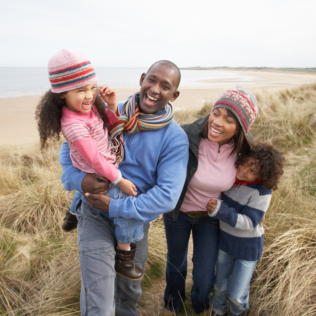 bigstock-Black-Family-on-a-beach-27384848.jpg