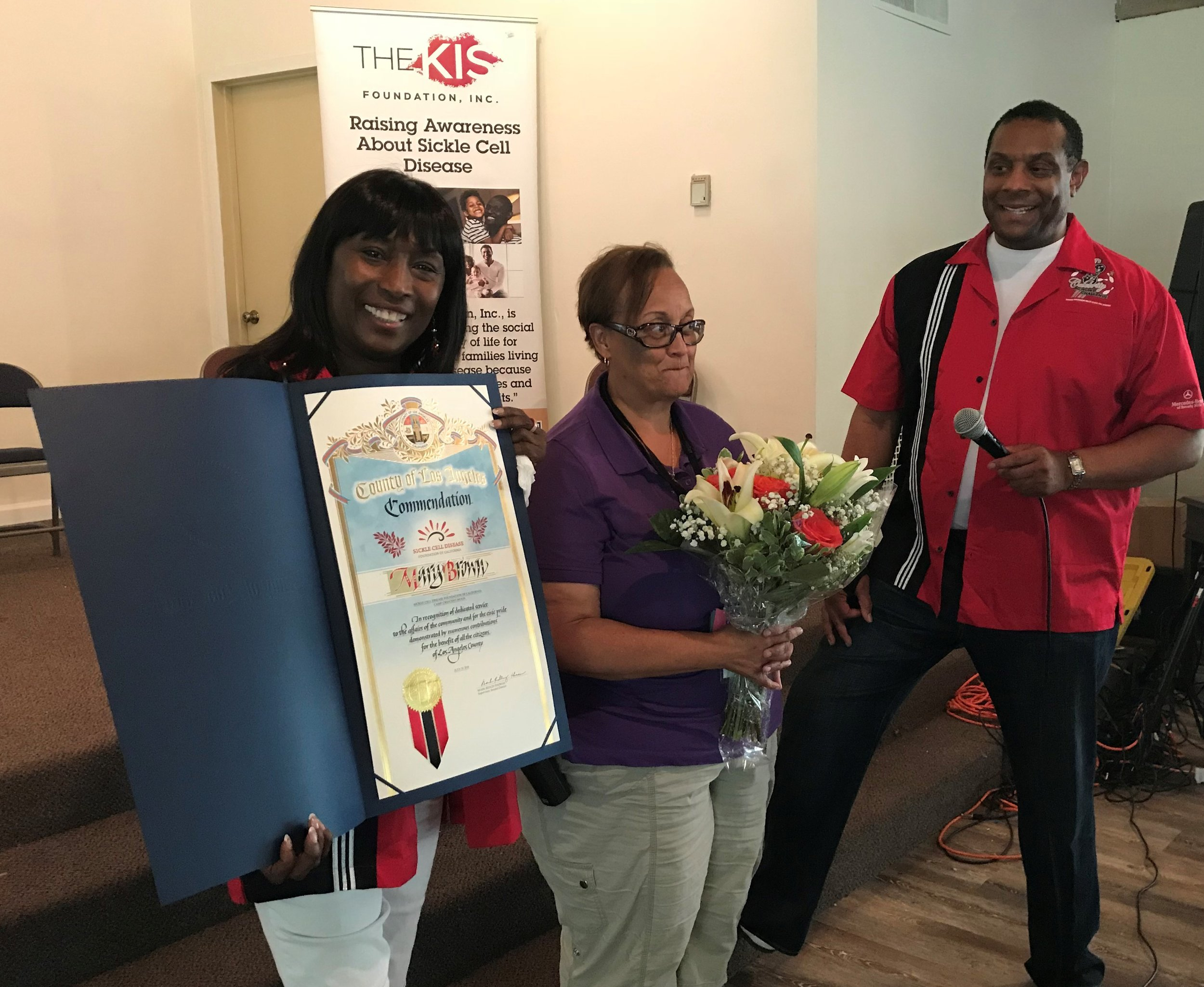 André Dawson, KISF Board Member, presented Mrs. Brown with flowers and a Commendation from Supervisor Mark Ridley-Thomas. We're so happy to present our State SCD Foundation with this well-deserved honor.