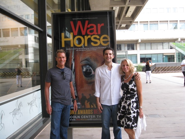 Beth with her husband and son Ben (in white) in front or War Horse billboard at Lincoln Center in NYC. Ben acted in the show for 1.5 years