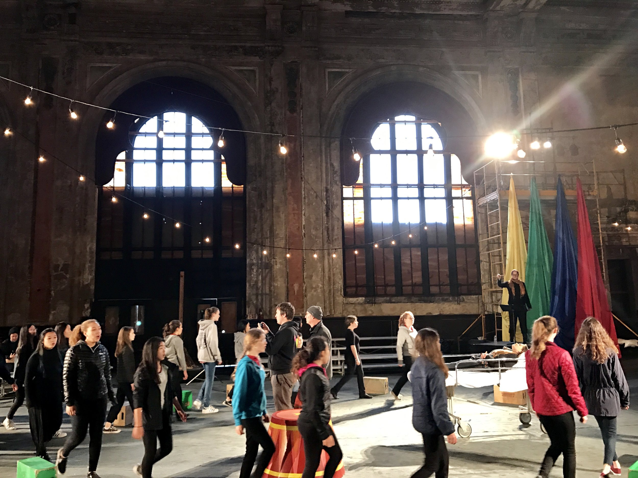 The SFGC, directed by Lisa Bielawa at the historic 16th Street Oakland Train Station, in rehearsal for the filming of Episode 11: Circus.