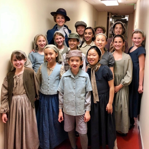 SFGC choristers in costume with alumna Silvie Jensen before opening night of Pagliacci at SF Opera!